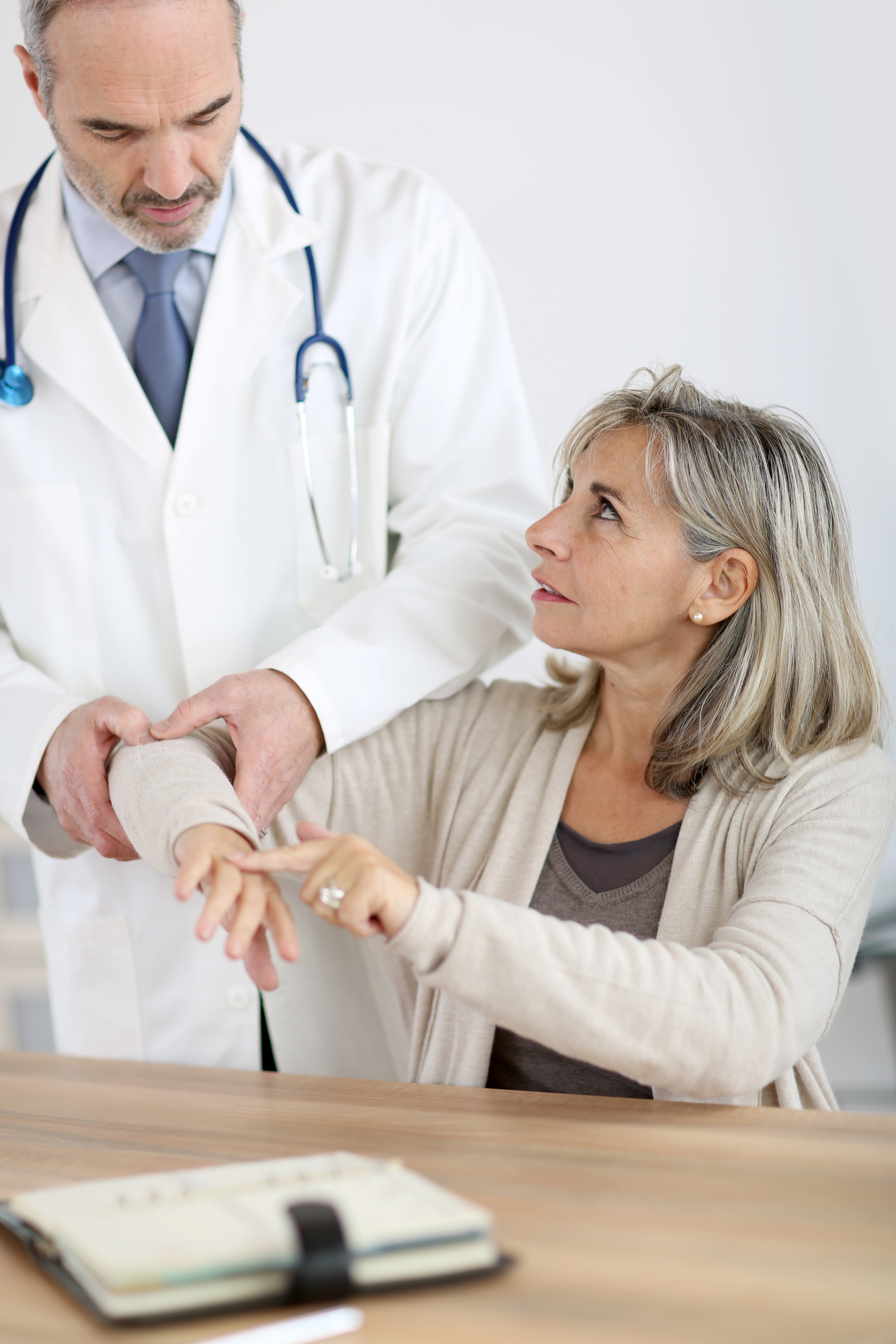 Patient consulting doctor for elbow pain and possible arthritis