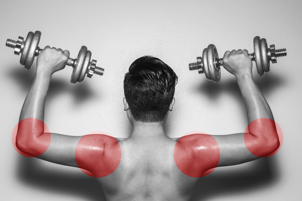 Man Lifting Weights - Showing Areas of Muscle Strain