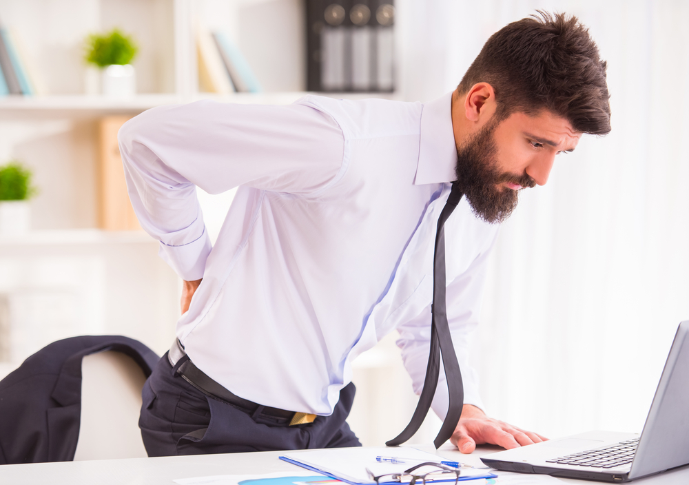guy-with-back-pain-at-desk