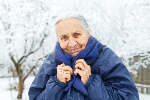 senior citizen out in the winter