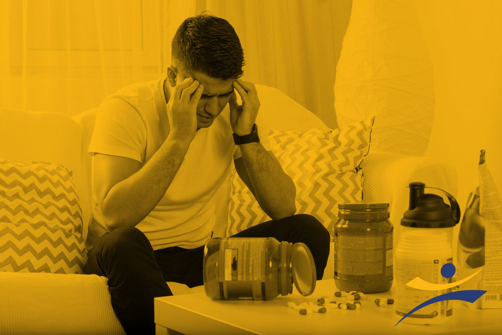 Athletic man in despair from taking supplements