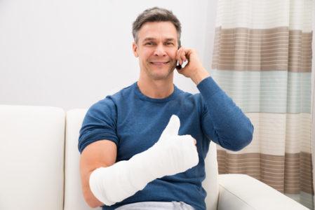 injured man thumbs up