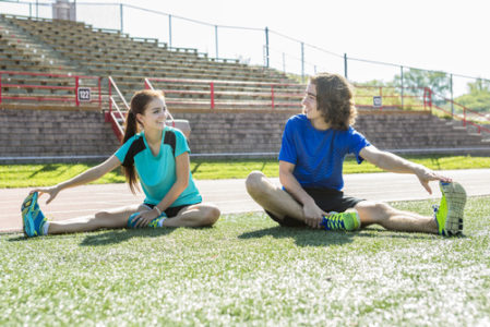 children stretching before running