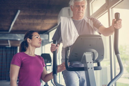 older man recovering with personal trainer