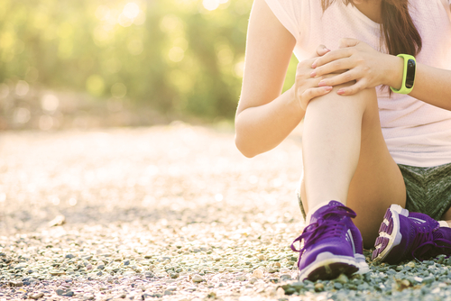 runner stopped to assess pain