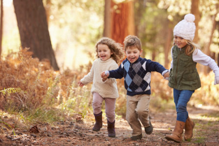 children running in the forest