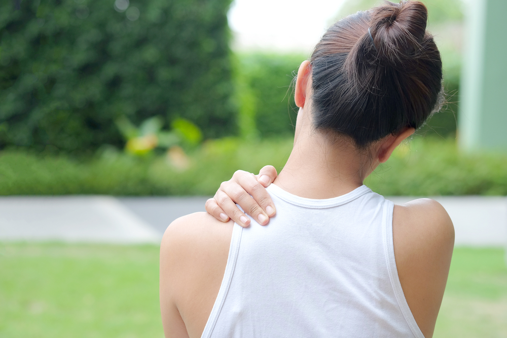 Women have neck pain, shoulder pain, at the park health concept